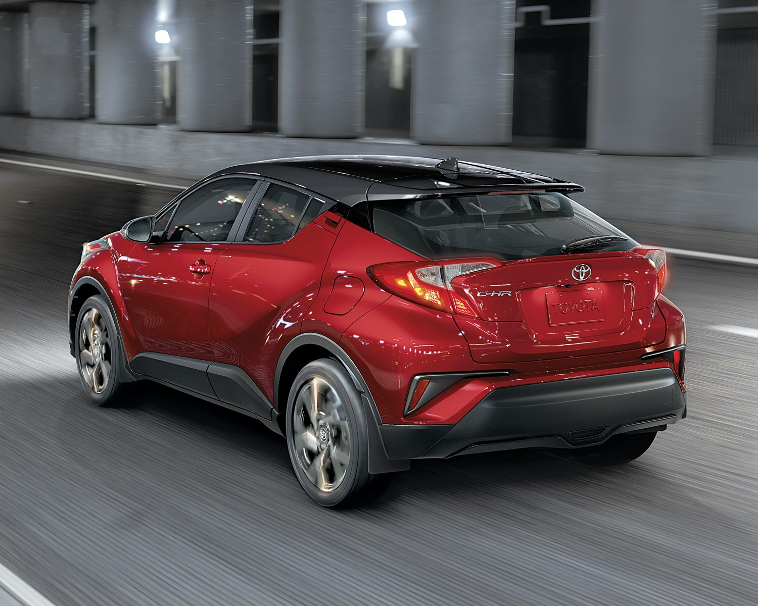 toyota-2019-toyota-c-hr-xle-premium-exterior-ruby-flare-pearl-rear-driving-l